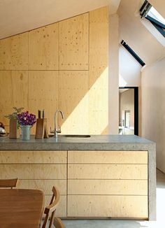 Starfall Farm, Wiltshire, UK, 2011 - Mitchell Taylor Workshop. Refurbishment and additions to a Victorian farmhouse.  Bespoke plywood kitchen joinery with a hand polished concrete kitchen bench.