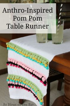 Make an Anthropologie inspired table runner - this is so much fun (love the pom poms)!