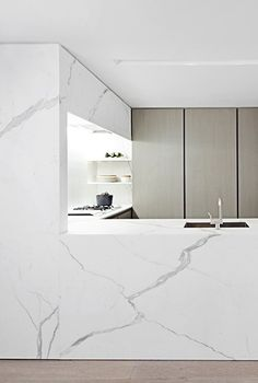 White Calacatta marble kitchen.  TEMPLER TOWNHOUSE, NEW YORK, NY
