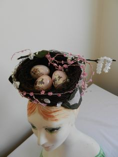 An Easter egg nest hat by Raymond Hudd.