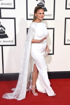 Pin for Later: 28 Grammy Awards Fashion Moments Too Fun to Miss Chrissy Teigen's Cape Had Spectacular Detail There was intricate beadwork on her Yousef Al-Jasmi gown. Pink Gowns, Satin Dresses, Maternity Dresses, Maternity Fashion, Stylish Maternity, Celebrity Dresses, Celebrity Style, Estilo Baby Bump, Dresses For Pregnant Women