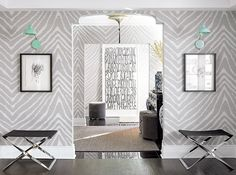 """""""This zebra-patterned wallpaper is the """"perfect backdrop,"""" I used it in many rooms in the apartment, which makes the effect more subtle. If you used it on one feature wall, it would scream at you."""" The two pieces of black-framed artwork are by Moïsette Boucher."""