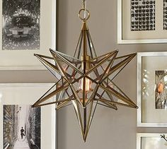 Glass Star Pendant- possibility for the dining room-but not this exact one-I've seen them made with iron instead of brass-and cheaper, too!
