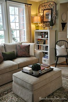 I like the picture in the basket on the wall Living Room Makeover - The Endearing Home