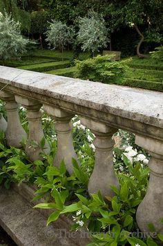 An elegant stone balustrade overlooking the sunken...