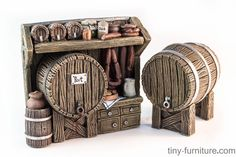 Some sort of wooden beer stand with an additional beer barrel.  Fully painted with acrilic paints.  Made of resin. A varnish coat added to avoid scratches in manipulation.