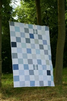 Patchwork quilt made from mens shirts.