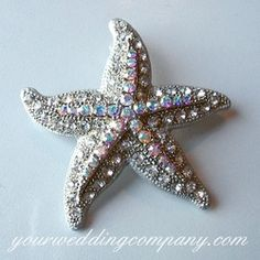 This gorgeous crystal starfish brooch goes perfectly with a beach or nautical-themed wedding.   Handmade with high-quality clear and aurora borealis Swarovski crystals. www.yourweddingcompany.com