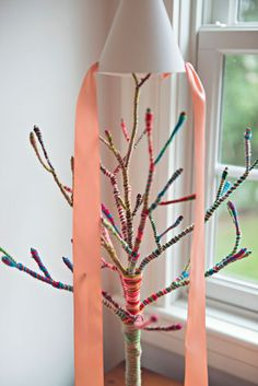 Jewelry display-- wrap branches in yarn (Designmom: Living With Kids: Jane Rhodes)