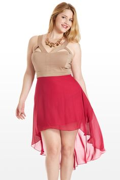 A feminine frock with a fitted nude bodice that dares to bare and a flowing high-low chiffon skirt. Empire waist flatters curves, while triangle cutouts over the bust, tank straps and open back are seductive. Pair with a modern statement necklace and bauble ring, then enjoy an unforgettable night out.
