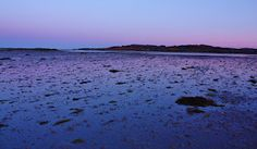 Western view at sunrise over The Strand Colonsay