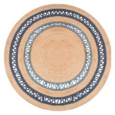 Jaipur's Sprial Elly rug presents casual style with contemporary panache. This circular layer showcases intriguing texture in woven jute, bordered with two openwork rings in shades of blue. This relaxed yet refined accent belongs in a beachfront foyer or lively breakfast book. 6' round. 8' round. Almond Buff & Dark Denim. Colors noted are Pantone TPX. 100% Jute. Vacuum regularly; professional cleaning recommended.