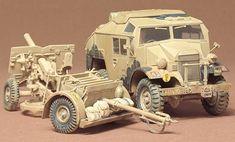 Assemble a British 25 PDR Gun & Quad Gun Tractor with this Scale Plastic Model Kit from the Tamiya Military Miniatures Series. A realistic reproduction of the Morris Quad tractor towing vehicle. Quad, Plastic Model Kits, Plastic Models, Maquette Tamiya, Tamiya Models, Hobby Toys, Military Diorama, Model Train Layouts, Panzer