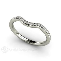 Sparkling diamonds accent this contoured wedding band in your choice of 14K or 18K White, Yellow or Rose Gold. This band measures 2mm wide and has
