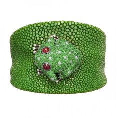 Green galuchat bracelet with a white gold frog set with 2 rubies, 289 green garnets, 10 white diamonds and 14 black diamonds by de Grisogono