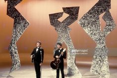 The Everly Brothers Phil Everly (left) and Don Everly perform on the NBC TV music show 'Hullabaloo' in February 1965 in New York City, New York.
