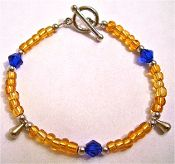 Handmade Gold & Blue Tear Drop Charm Bracelet.  $20.00 http://shop.prettywingsdesigns.com/Gold-Blue-Tear-Drop-Bracelet-BSBWS001.htm