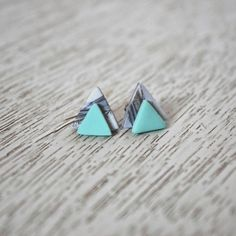 So simple and cute https://www.etsy.com/listing/384953054/teal-and-marble-stacked-triangle-polymer