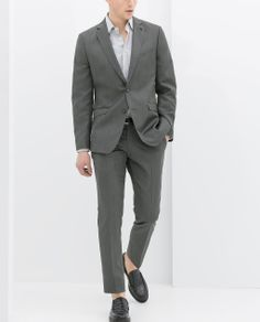 i'd go with a slightly darker gray on tony if the groomsmen are in a lighter gray. this suit looks pretty sharp!