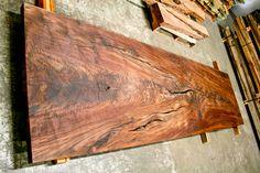 Walnut wood slab dining table.