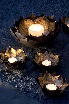 These metal Lotus Flower Candle bowls have a gold leaf center to reflect the light. small 5 diameter x large 10 diameter x gold finished metal not Lotus Candle Holder, Candle Holders, Candle Lanterns, Floating Lanterns, Restaurant Design, Belle Photo, Outdoor Lighting, Candle Lighting, Wedding Lighting