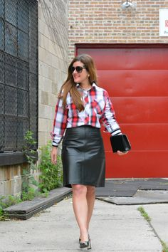 Anna from @annabaun pairs a plaid shirt with her J.Jill leather skirt.