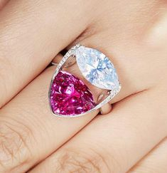 Set with a natural vivid pink sapphire, we completed this ring with a fancy white marquise, the two rare colors accentuate each other and create a Beautiful style. White gold 18 k. Very Beautiful ring  SLVH ♥♥