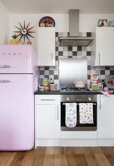 At Home With Natasha Denness - I LOVE this kitchen.  Someone send me a pink retro fridge please! ;)