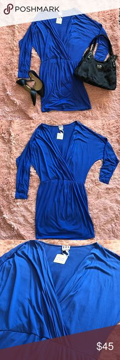 """NWT Haute Hippie Cobalt Blue Ruched Wrap Dress NWT Haute Hippie cobalt blue ruched wrap dress. Buttery soft to the touch and flatters your figure. Cut for a slightly loose fit with a closer fit at the waist. • Draped wrap-effect front, elasticated waistband, partially lined • Long sleeves • Ruched side • Approx. 39"""" length • 100% modal Haute Hippie Dresses Mini"""