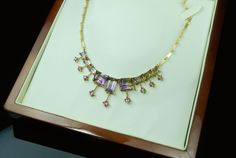 Ametrine and pink sapphire necklace handcrafted in 18k gold.