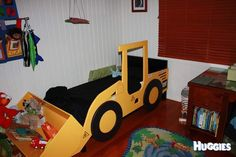 Digger toddler bed. It's not really my style, but gee, the boy would love it.