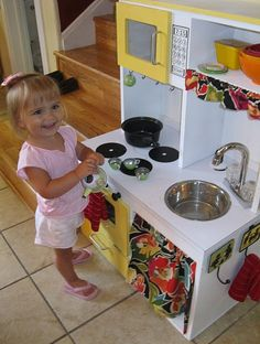 diy play kitchen (no explicit tutorial but lots of great tips on how to make your own)