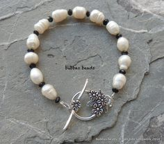 Pearl & crystal bracelet with flower toggle clasp. www.facebook.com/bubbasbeads