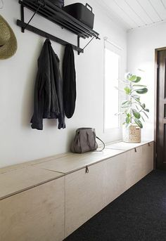 Hall cloakroom with Bank off wood with storage space
