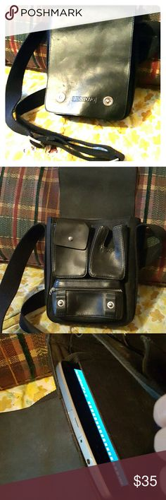 Extremely nice Octovo crossbody/shoulder bag Only carried a couple times.  Black leather with some woven parts. Silver hardware in good condition. All snaps/zippers work. No stains or defects, barely shows any wear. Has a special secret compartment sized just right to protect/carry your kindle, Ipad Mini, or tablet. The long black woven strap is adjustable with silver buckles. Cute pockets under the flap to keep cards, lipstick, cash etc organized. octovo Bags Crossbody Bags