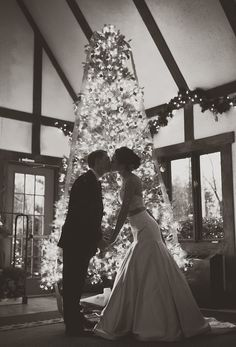Kissing in front of a Christmas Tree - Must have photo for winter weddings!