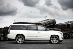 Customized Cadillac Escalade with a gloss black wrapped two-tone (roof, pillars, window and rear hatch trim), painted red brake calipers, and lowered on Gianelle wheels. Future Trucks, Chevy Girl, Cadillac Escalade, Gmc Trucks, Brake Calipers, Gliders, Cars Motorcycles, Dream Cars, Boats