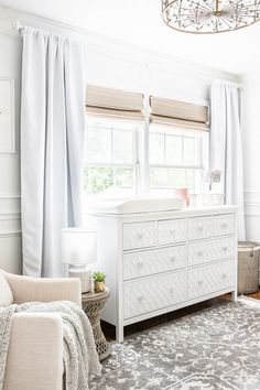 A guide for hanging curtains correctly to make windows appear larger and ceilings appear taller + favorite blackout curtains, shades, and rods for less.