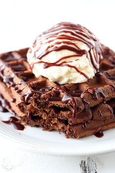 Fudge Waffles are the ultimate dessert for breakfast loaded with rich chocolate flavor and topped with ice cream and fudgy chocolate sauce!