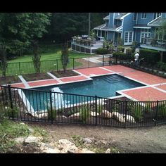 Swimming pool deck using bluestone and traditional clay pavers (by www.NeavePools.com)