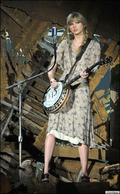 Her banjo has the number 13 on it