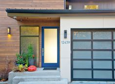 """Exuberant blue, privacy glass provide a strong visual anchor to this simple but striking, rectilinear """"entryway composition"""""""