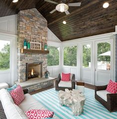 Screened in porch, This summery and cheerful screened-in porch features stained T&G ceiling boards, Cheerful and summery Screened in porch decor ideas, Screened in porch with stone fireplace #Screenedinporch Grace Hill Design #coastalcottageexterior #landscapefrontyardwithstone