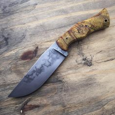 W2 blade. Tapered tang with maple ambrosia handle, black micarta pins and brass lanyard tube.