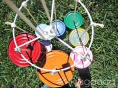 tomorrow i will participating in design dazzle's kids summer camp again. so i thought today i would repost the post i posted last year for their summer camp post. post. it's a tin can wind chime…hand painted and decorated by my kiddos… we gathered together some cans I spray painted them all cause frankly…we love color! (this …