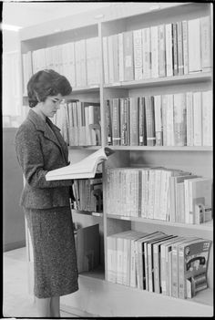 319419PD: Peggy Ellis at the directories, State Reference Library, Perth, 1961 https://encore.slwa.wa.gov.au/iii/encore/record/C__Rb3430621
