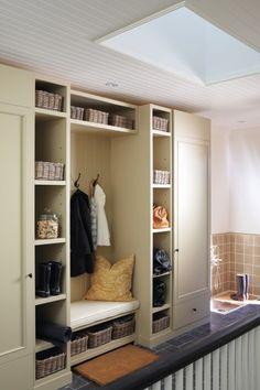 Skylight, wood paneled ceilings, and mudroom cabinets