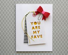 handmade card  by L. Bassen ...tags as focal point ... negative space die cut sentiment backed in chromium yellow ... black and white striped tag peeking out from the top one ... bright red paper bow l ... for fashion challenge ... great interpretation with all of the elements ... luv it