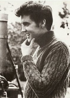 Only Elvis can make turtle neck sweaters look good