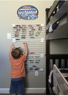 My children are crazy about Hot Wheels. They are taking over our house and not just the cars but the tracks, jumps, loops, boosters and all things car. Hot Wheels Storage, Car Storage, Storage Shelves, Hot Wheels Display, Car Themed Bedrooms, Bedroom Wall Colors, Baby Boy Rooms, Kids Rooms, Cool Rooms